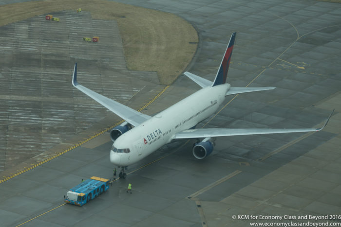 Delta Boeing 767-300 beingtowered out - from Heathrow Tower